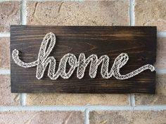 home - on a stained rustic wood board. Perfect for a housewarming gift.