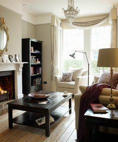 classy and simple living room, gray walls with tan and white sofas, black furniture, feminine touches