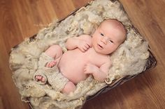 newborn baby boy wearing leg warmers lying in a basket, unique fine art baby portraits by Olga Klofac Professional Baby Photographer Charlestown Mayo