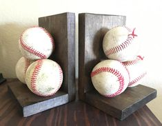 These baseball bookends are a great addition to any baseball fans room or mans office. These balls are all different and rugged creating a great weathered look. Some ball seams are ripped more than others and all are But Football, Baseball Boys, Baseball Crafts, Baseball Birthday, Olympic Football, Baseball Boyfriend, Baseball Wreaths, Baseball Helmet, Baseball Teams