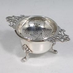Tea Strainer | Sterling silver tea strainer and bowl, having a round hand-pierced ...