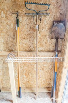 Wire shelving for rakes and shovels | Easy and Inexpensive Ways to Organize Garden Tools