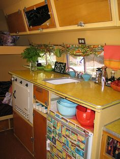 Airstream Kitchen. Love the yellow formica countertops!