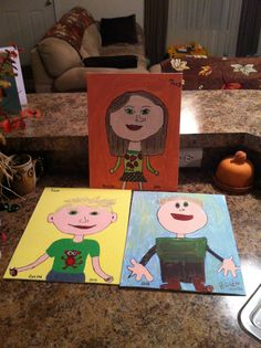 Self Portraits painted on Canvas bought at Wal-Mart($4.97 for 3 10x14).  Painted with acrylic paint and out lined in Black Sharpie...think they did great!