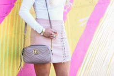Transitioning into spring in a blush lace-up skirt with Chicwish.