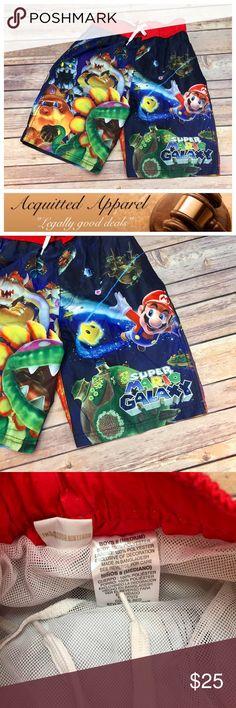 "[Nintendo] Mario Boys Swim Trunks Boys Nintendo super Mario galaxy swim trunks size 8 / medium brand new without tags. Waist measures approx. 22"" not stretched. Inseam measures approx. 7.5"". Rise measures approx. 10"". Fabric content: 100% poly. **location A-19"" Nintendo Swim Swim Trunks"