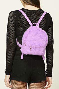 PEDIDOS SOLO POR #ENCARGO  #CatálogoNoviembre2016  Código: F-46 Faux Fur Mini Backpack Color: Purple Precio: ₡23.900  Whatsapp  ☎8963-3317, escribir al inbox o maya.boutique@hotmail.com  Envíos a todo el país. #MayaBoutiqueCR ❤
