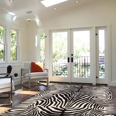The Madagascar rug MDG01 offers fashionable black and ivory animal print by the leading American Designer, Barclay Butera.