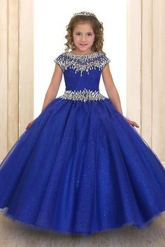 Plaire - Crystal Stone Trim Pageant Gown in Royal BlueCrystal Stone Trim Pageant Gown in Royal Blue Plaire - Style CA114 Hundreds of light catching stones in this beautiful pageant gown. A long gown that reaches the floor and fits like a bell. This dress is multi layered, and features stones and a sheer panel.