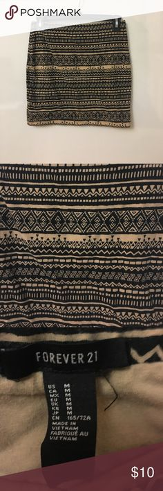 "❤️ Forever 21 Tribal Pattern Bodycon Skirt Forever 21 body con skirt with tribal pattern. Want more bang for your buck? Can be worn as a tube top too!  ☀️The Deets☀️ Size Medium  black and tan pattern  92% cotton, 8% spandex  15"" length  26"" waist all the way around  Reasonable offers accepted!! Check out my other Forever 21 listings. I love to bundle  Forever 21 Skirts Mini"