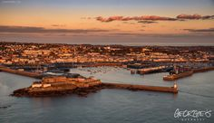 February dawn over St Peter Port #Guernsey #GreatThings   Link to the whole collection of 'Georgie's Guernsey' :-http://chrisgeorge.dphoto.com/#/album/4daaes  Picture Ref: 27_02_16 — in St. Peter Port, Guernsey, Channel Islands.
