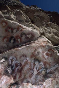 Hand prints made 10,000 years ago at Cueva de los Manos, Argentina; photo by James P. Blair