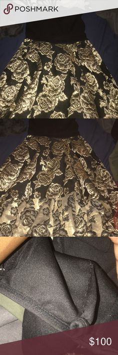 Black high low prom dress Black and gold high low strapless dress, i don't exactly know the size but i had it taken in in the back to fit my chest it can be cut though to go back to the way it was before Dresses Strapless