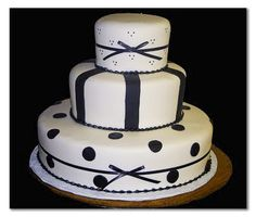 wedding cakes, stripes cakes, polka dots cakes, black and white cakes, 3 tier cakes, specialty cakes, http://tiered-expressions.com