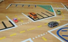 Playing with washi tape & cars - your cheekie lil monkie will be occupied for hours with this great idea