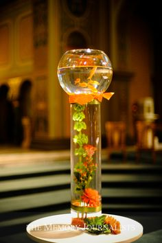 Here's a fun goldfish centerpiece, can do around the Mill. I really love this but with different fish to go with the color theme. Non Floral Centerpieces, Wedding Table Centerpieces, Floral Arrangements, Bowl Centerpieces, Fish Bowl Centerpiece Wedding, Bridal Table, Centerpiece Ideas, Goldfish Centerpiece, Fishbowl Centerpiece