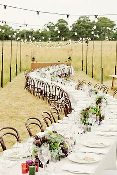 rustic: gorgeous rehearsal dinner or reception table decor and setup - love the overhead lights #serpentine #table #setup