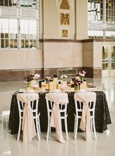 I actually really like this idea. The blocks/pedestals add a different dimension to the table and allow candles as well as flowers to be added to the table scape. I would, however, have them in glass/plexiglass to intertwine with the glass candle holders. I also really like the small bouquets rather than large centerpieces....maybe intertwined with the candle holders. Or alternate tables between the two designs.