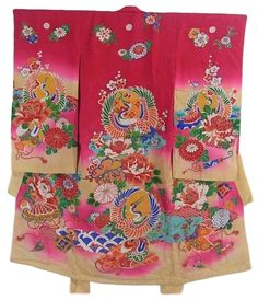 This is a charming girl's vintage kimono with 'Tsuru' (crane) circle, seasonal flowers and takara-zukushi (treasure assortment) design, which is dyed