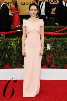 Felicity Jones is airy and elegant in off-the-shoulder blush hued Balenciaga—a seamless modernization of '50s glamour.   - HarpersBAZAAR.com
