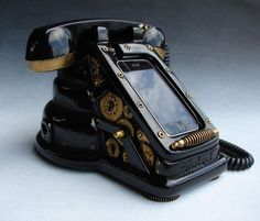 "Take a look at the iRetrofone Steampunk dock for iPhone, how cool. ""The iRetrofone Steampunk dock for iPhone from freelandstudios is hand-sculpted and hand-cast in thick urethane resin. Using your own docking cable, the iRetrofone dock. Design Steampunk, Arte Steampunk, Style Steampunk, Steampunk Fashion, Victorian Steampunk, Steampunk City, Steampunk Artwork, Steampunk Crafts, Steampunk Lamp"