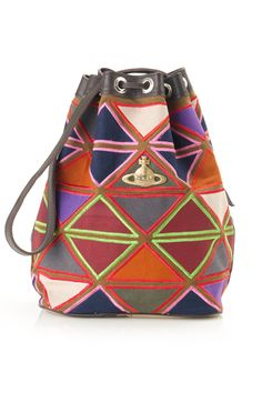 Ethical Africa Collection - by Vivienne Westwood  A unisex range that comprises rucksack totes, drawstring bags and clutches, it was inspired by African fabrics - the colours and embroidery - and has been created using recycled canvas, reused roadside banners, unused leather cut-offs, recycled brass and discarded metal padlocks and car parts.