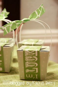 Use Christmas ribbon to wrap these take out boxes.  Fill with candy for gift giving.