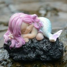 Little Sleeping Mermaid on Rock www.teeliesfairygarden.com Isn't she lovely? What could she be dreaming of? Enchant your fairies and their friends with this lovely little sleeping mermaid on her rock. #fairymermaid