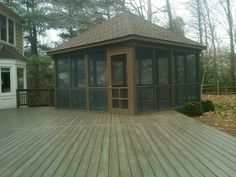 this rustic screenedin porch is reminiscent of cabins at summer camps - Screened Gazebo