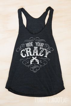 """Brand new! This """"Hide Your Crazy"""" tank top has all the right attitude, and is perfect for your next country concert. Available in S-XL. Pick one up today at tumbleroot.com"""