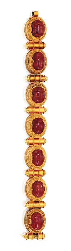 ARCHAEOLOGICAL-REVIVAL GOLD AND CARNELIAN SCARAB BRACELET, CIRCA 1860.  The articulated bracelet set with seven carved carnelian scarabs, the reverse of each engraved in the a globolo style featuring figures and scenes from ancient Greek and Etruscan mythology, each scarab held within wirework and filigree bezels, spaced by batons accented by gold wire, length 7 inches.