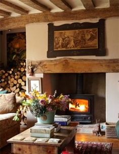 I tell you I'd rather have a wood burning stove than a fireplace. I love this country cottage living room and the log storage! Style Cottage, English Cottage Style, English Country Cottages, English Country Decor, Cozy Cottage, English Cottage Interiors, Cottage Lounge Ideas, English Cottage Decorating, French Country