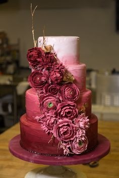 A beautiful Burgundy ombre cake featured at The Hotel at the Kirkwood center.