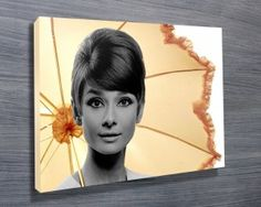 Audrey Hepburn Umbrella Canvas Print from $26.00. This stretched canvas art print depicts the famous photoshoot of Audrey Hepburn featuring with an umbrella. As with all art on this site, we offer these prints as stretched canvas prints, framed print, rolled or paper print or wall stickers / decals.  http://www.canvasprintsaustralia.net.au/  #Wallartonline #Wallart #Photocollageoncanvashigh