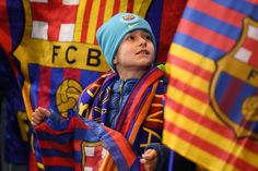 A young Barcelona fan looks on ahead of the UEFA Champions League Round of 16 First Leg match between Chelsea FC and FC Barcelona at Stamford Bridge on February 20, 2018 in London, United Kingdom.