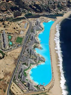The Largest Pool in the World. This giant lagoon is located on the coast of the Pacific Ocean, near the small town of Algarroba in Chile. Crystal Lagoon is also the deepest swimming pool in the world. swimming pools, small town, swim pool, largest pool in the world