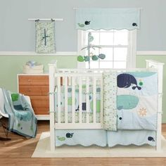 Ocean themed nursery. I like the green and blue wall with chair rail. I think I would use a warmer blue.