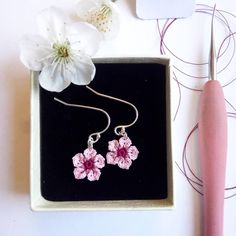 Hi - I crochet tiny flowers! I know cherry blossom season has been and gone but I just wanted to share these. Crocheted with a hook and fine cotton Crochet Wallet, Lucite Flower Earrings, Cherry Flower, Cherry Blossom Season, Crochet Decoration, Blooming Rose, Tatting Lace, Tiny Flowers, Flower Applique