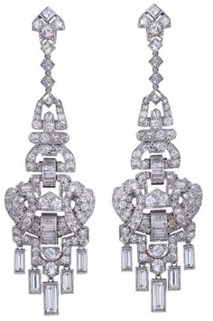 A Pair of Art Deco Diamond Ear Pendants.  UK,  Art Deco.  Each designed as an articulated open work pendent geometric motif, set with circular- and single-cut diamonds, to a baguette-cut diamond fringe, circa 1930, probably English.    Listing via 1stdibs.