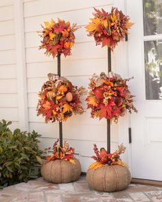 Our Autumn Acorn Foliage is a colorful vision of abundance, adding vibrant cheer to any space.Add a vintage touch to your fall decorations with Balsam Hill's Autumn Acorn Wreath and Topiaries.From wreaths to lawn signs and more, these are the fall-in Outside Fall Decorations, Harvest Decorations, Outdoor Decorations, Fall Topiaries, Fall Floral Arrangements, Autumn Decorating, Decorating Ideas, Porch Decorating, Decor Ideas