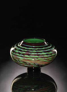 Hand Blown glass bowl with accents in green and earth tones. The wrapped color lines give the movement of a handwoven rug. Glass Tapestry Bowl in glass by Bernard Katz.