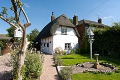 Rich past: The Thatched Cottage is thought to be the oldest house in the village of Stoke Mandeville. It is said to be whereHenry VIII met with Anne Boleyn while he was still married to Catherine of Aragon