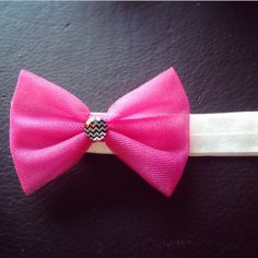 Hot pink tulle bow with detachable headband. $7
