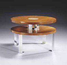 Robert Mallet-Stevens (1886-1945)  Table basse, vers 1930  En placage de noyer, à deux plateaux circulaires, réunis deux à deux par quatre lames en fer chromé, tout comme le piètement quadripode, en retour à la base Hauteur : 60 cm. (23 5/8 in.) ; Diamètre : 90 cm. (35½ in.)  Monogrammée 'MS'des initiales de Michel Souillac et numérotée 'XV'