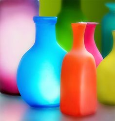 From traditional forms like these bright glass bottles to abstract sculpture and art glass that looks like paintings, the glass art movement is diverse. Colored Glass Bottles, Bottles And Jars, Colored Vases, All The Colors, Bright Colors, Colours, Bright Art, Bright Eyes, Neon Colors
