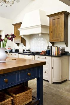 .white tile, painted cupboards, love the cobalt blue & butcher block table