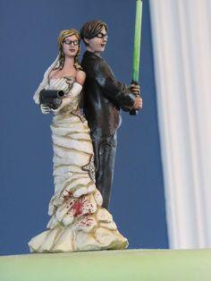 Zombie apocalypse light saber wedding topper! Where was this when you & Jake got married @Leah Vialpando ??
