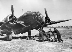 Friday 2 August 1940 Using a bomb trolley to load up a Handley Page Hampden, 2 August Battle of Britain : The rainy summer of . Navy Aircraft, Aircraft Photos, Ww2 Aircraft, Bristol Blenheim, Battle Of Britain, Royal Air Force, Luftwaffe, World War Two, Wwii