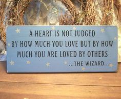 A Heart is not Judged Wizard Of Oz Painted Wood Sign Primitive Blue. $15.95, via Etsy.