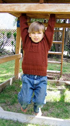 Dress your favorite sailor boy in this gansey-style pullover with aran detailing and a nautical flair. Pattern by Debi Tuttle